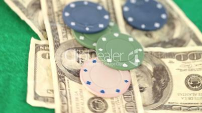 Poker coins and bills thrown on a gambling table