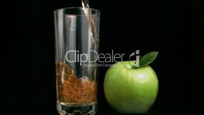 Fresh apple juice flowing in super slow motion