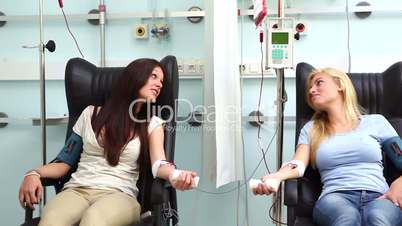 Two patients receiving a blood transfusion
