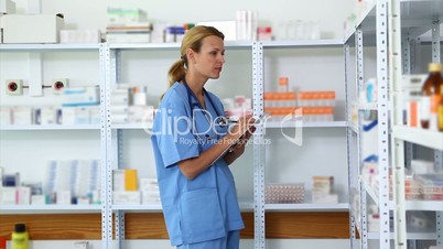 Blonde pharmacist holding a clipboard
