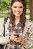 Portrait of a cute teenager with a smartphone