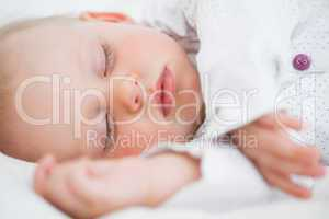 Peaceful baby lying while falling asleep