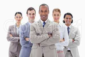 Close-up of a business team smiling and crossing their arms
