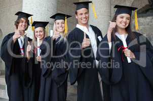 Graduates posing the thumb-up