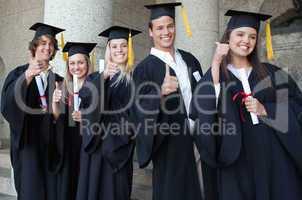 Graduates posing the thumb-up
