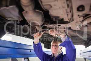 Mechanic using tools