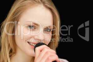 Young woman smiling while singing