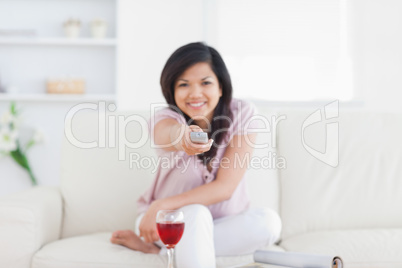 Woman holding a remote while sitting