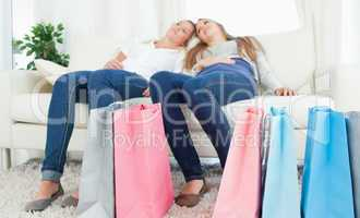 A pair of sisters exhausted after shopping