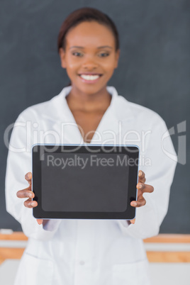 Focus on a black woman holding a tablet computer