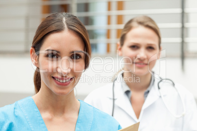 Smiling nurse and doctor standing