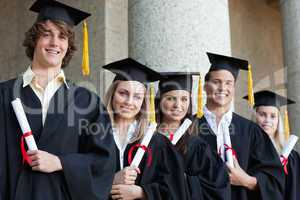 Close-up of five graduates students posing