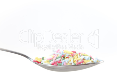Multicolored sprinkles on the spoon
