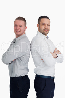 Two men standing back to back
