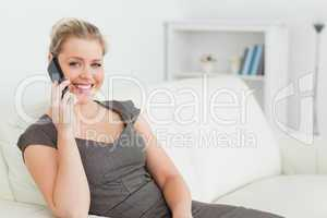 Woman calling with her mobile phone
