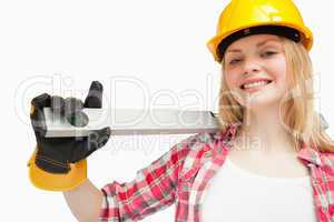 Young woman holding a spirit level