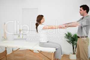 Manual stretching being made by a doctor