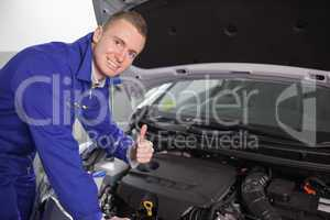 Smiling mechanic with his thumb up