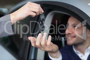 Man receiving car keys