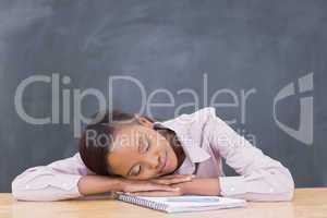 Black woman leaning her head on desk with closed eyes