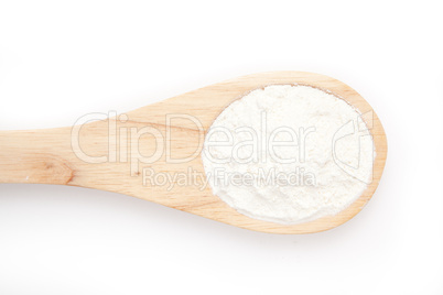Wooden spoon with flour