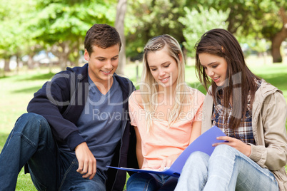 Three teenagers studying together
