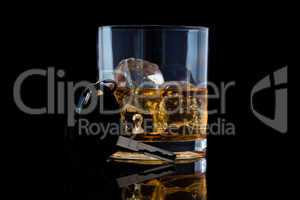 Tumbler glass with whiskey and a car key