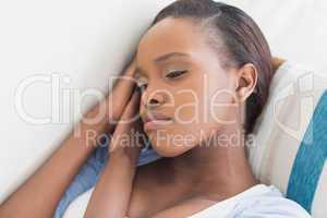 Sad black woman lying