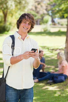 Portrait of a young man using a smartphone
