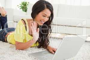 Beaming Latin woman on a video chat