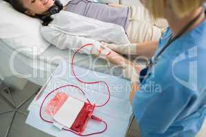 Nurse taking care of a transfused patient