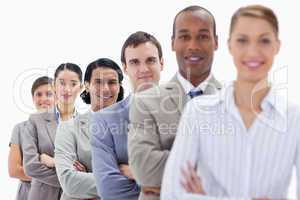 Close-up of workmates dressed in suits crossing their arms in a