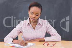 Serious teacher writing