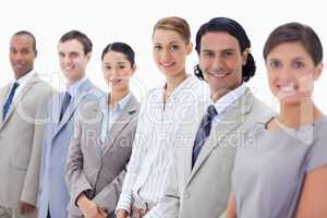 Close-up of smiling business people looking straight