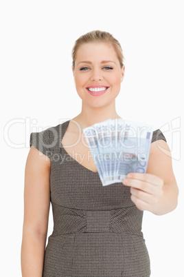 Woman smiling showing a euro banknotes fan