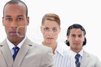 Big close-up of a serious business team in a single line