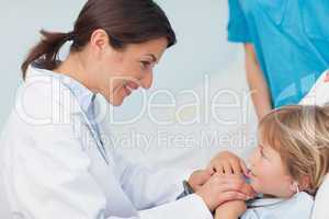Doctor holding hands of a child
