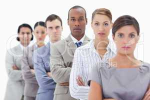 Big close-up of a serious business team in a single line crossin