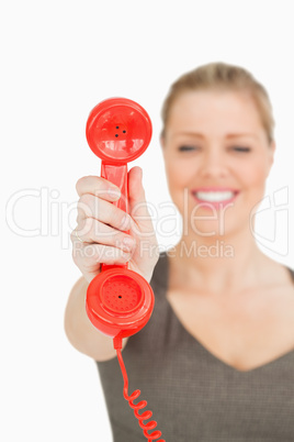 Blurred woman showing a retro phone