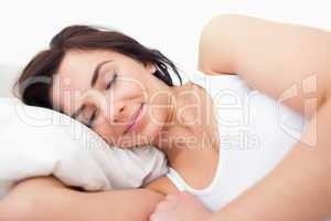 Peaceful woman lying while sleeping in the morning
