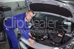 Mechanic repairing an engine of car