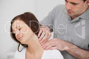 Man massaging the neck of his patient