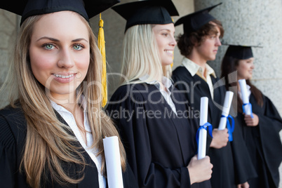 Close-up of a blonde graduate with blue eyes