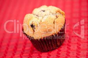 Muffin on tablecloth