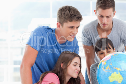 People looking at the globe of the world