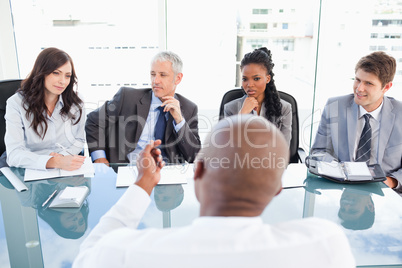 A manager and one employee talking to each other during a meetin