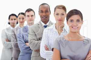 Big close-up of a business team in a single line crossing their