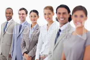 Close-up of happy business people looking straight