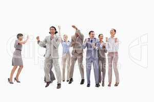 Very happy business people jumping and clenching their fists