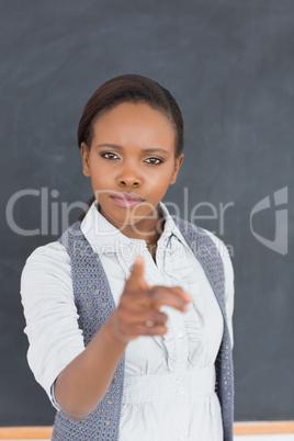 Serious teacher finger-pointing